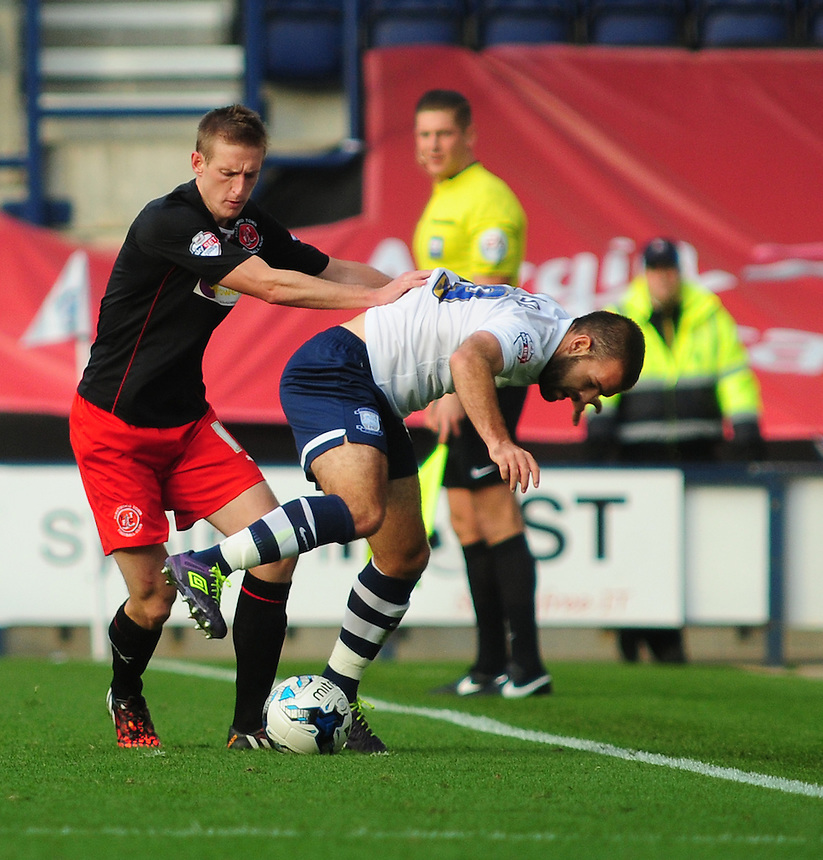 Preston North End's John Welsh is fouled by Fleetwood Town's Jeff Hughes<br /> <br /> Photographer Chris Vaughan/CameraSport<br /> <br /> Football - The Football League Sky Bet League One - Preston North End v Fleetwood Town - Saturday 25th October 2014 - Deepdale - Preston<br /> <br /> &copy; CameraSport - 43 Linden Ave. Countesthorpe. Leicester. England. LE8 5PG - Tel: +44 (0) 116 277 4147 - admin@camerasport.com - www.camerasport.com