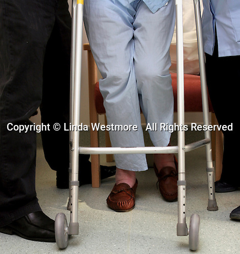 Physiotherapy session for elderly gentleman on the ward.