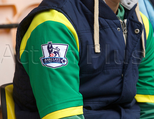 20.04.2014.  Norwich, England.  For how much longer? Premier league badge on the Norwich City shirt worn by a fan before the Barclays Premier League match between Norwich City and Liverpool from Carrow Road.