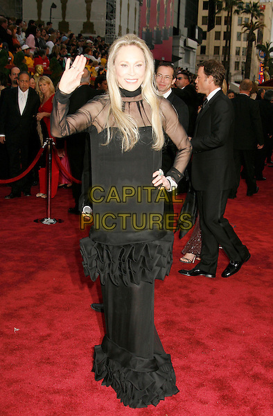 FAYE DUNAWAY .The 79th Annual Academy Awards - Arrivals held at the Kodak Theatre. Hollywood, California, USA,.25 February 2007..oscars red carpet full length black dress hand on hip  waving.CAP/ADM/RE.©Russ Elliot/AdMedia/Capital Pictures.
