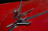 sculpture shaped like a bird on red oldtimer in Havana, Cuba