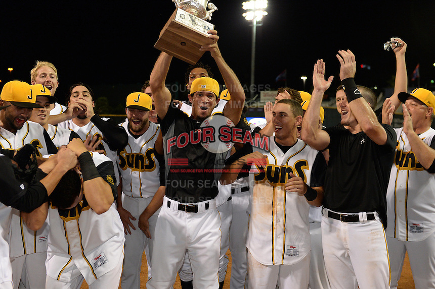 Jacksonville Suns players including Jheyson Manzueta (holding trophy), Austin Barnes, and J.T. Realmuto celebrate after game three of the Southern League Championship Series against the Chattanooga Lookouts on September 12, 2014 at Bragan Field in Jacksonville, Florida.  Jacksonville defeated Chattanooga 6-1 to sweep three games to none.  (Mike Janes/Four Seam Images)