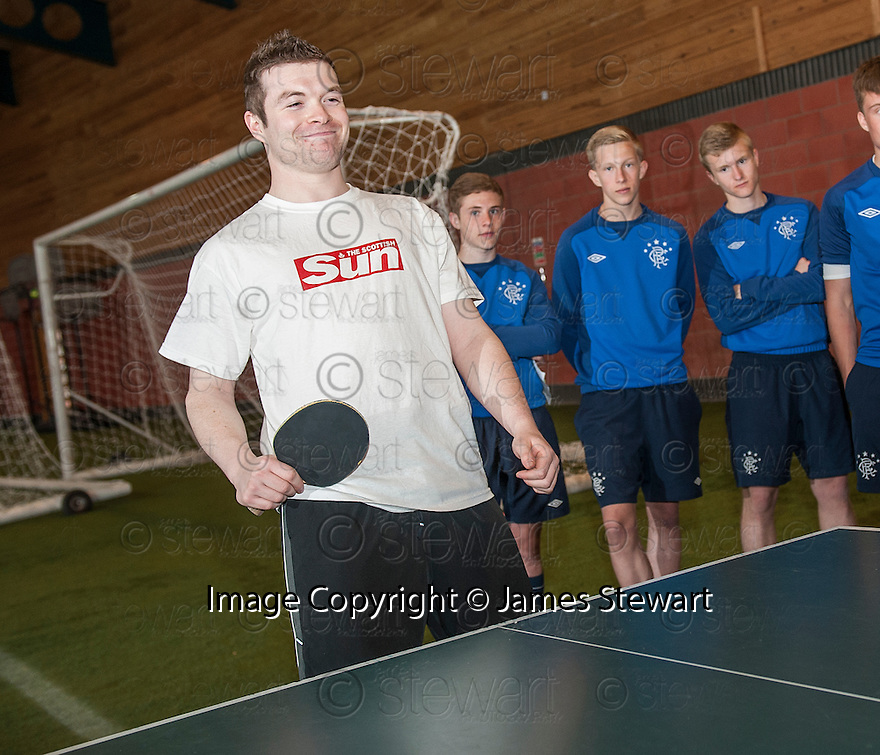 Sun Sport reporter Kenny Millar looks chuffed after winning his only point in a Table Tennis Challenge Match by Rangers' Junior Ogen .