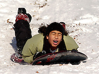 Jaylin Marcus of Hatfield, Pennsylvania enjoys a day of sledding after a winter snow storm closed schools December 9, 2005 in Doylestown, Pennsylvania. The Philadelphia region was hit with alomst 8 inches of snow, closing schools and some businesses. Photo by William Thomas Cain / photodx.com
