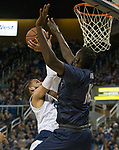 Nevada forward Cody Martin (11) shot is blocked by Akron's Deng Riak (10) in the first half of an NCAA college basketball game in Reno, Nev., Saturday, Dec. 22, 2018. (AP Photo/Tom R. Smedes)
