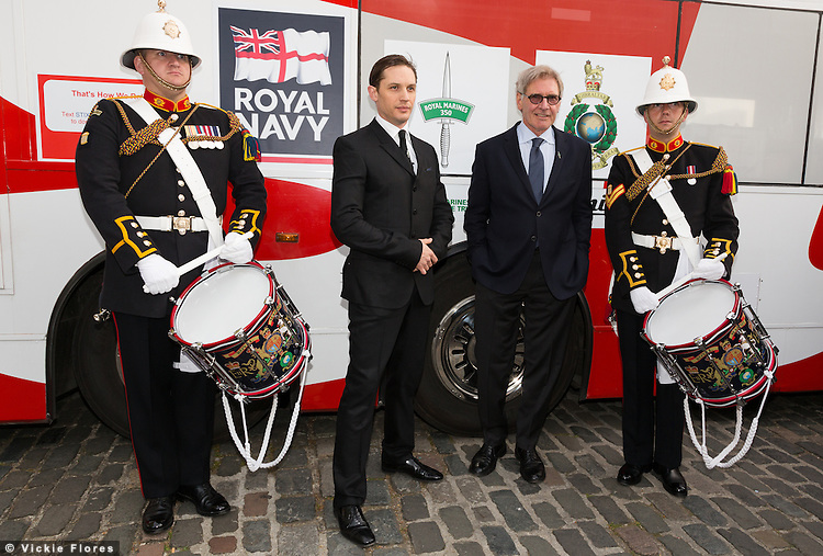 Royal Marines pose outside the Tower of London on 30th April 2014 with Tom Hardy and Harrison Ford. The Royal Marines Corps of Drums are attempting to break the World record for the longest continuous drum roll as part of a year of celebrations to mark the 350th anniversary of the Royal Marines and raising money for the Royal Marines Charitable Trust Fund.  The current record stands at 28 hours, 19 minutes and 3 seconds and they hope to extend this to 64 hours.