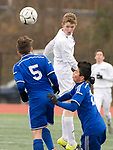 NEW BRITAIN, CT-111817JS06- Lewis Mills' Braden Fox (2) teams the ball up field in front of Suffield's Kenneth Bigos (5) and Aidan Werenski (20) during their Class M state final game Saturday at Willow Brook Park in New Britain.<br /> Jim Shannon Republican-American