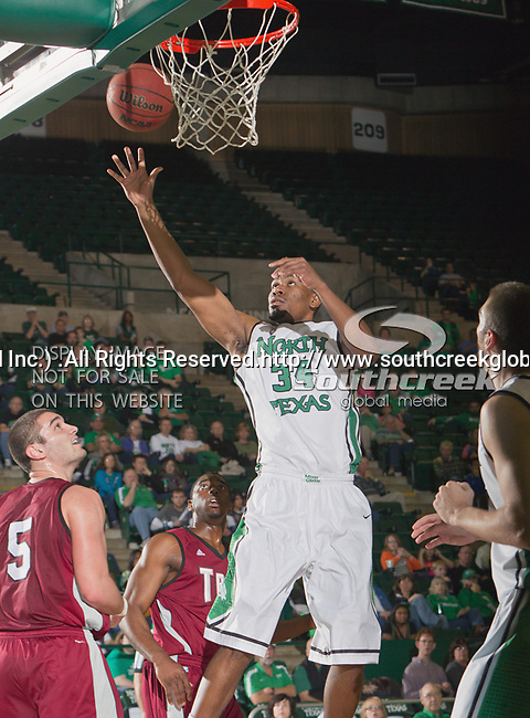 North Texas Mean Green forward Alonzo Edwards (34) in action during the game between the Troy Trojans and the University of North Texas Mean Green at the North Texas Coliseum,the Super Pit, in Denton, Texas. UNT defeats Troy 87 to 65.....