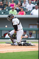 Charlotte Knights catcher Kevan Smith (32) blocks a throw at home plate during the game against the Gwinnett Braves at BB&T BallPark on July 3, 2015 in Charlotte, North Carolina.  The Braves defeated the Knights 11-4 in game one of a day-night double header.  (Brian Westerholt/Four Seam Images)