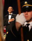 United States President Barack Obama stands with his hand over his heart during the pledge of allegience at the start of the annual White House Correspondent's Association Gala at the Washington Hilton Hotel, Washington, DC, Saturday, April 30, 2011..Credit: Martin Simon / Pool via CNP