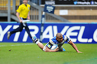 Jonathan Joseph looks to score a try but the score is later ruled out by referee Romain Poite. Amlin Challenge Cup semi-final, between London Wasps and Bath Rugby on April 27, 2014 at Adams Park in High Wycombe, England. Photo by: Patrick Khachfe / Onside Images
