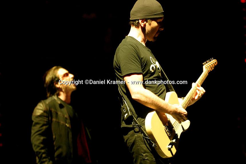The Edge performs with U2 at the Toyota Center in Houston, Texas on October 28, 2005 as part of the Vertigo Tour.