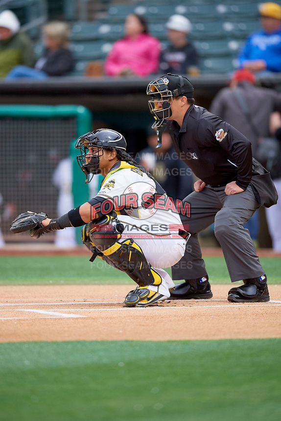 Jose Briceno (10) of the Salt Lake Bees during the game against the Albuquerque Isotopes at Smith's Ballpark on April 24, 2019 in Salt Lake City, Utah. Umpire Sean Ryan handles the calls behind the plate. The Isotopes defeated the Bees 5-4. (Stephen Smith/Four Seam Images)