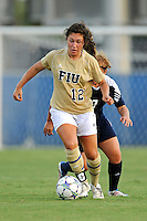 27 August 2011:  FIU's Kelly Ann Hutchinson (12) moves the ball upfield with Akron's Ashley Hughes (7) in pursuit in the first half as the FIU Golden Panthers defeated the University of Arkon Zips, 1-0, at University Park Stadium in Miami, Florida.