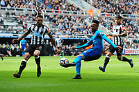 Pierre-Emerick Aubameyang of Arsenal crosses to Alexandre Lacazette of Arsenal who opens the scoring during Newcastle United vs Arsenal, Premier League Football at St. James' Park on 15th April 2018