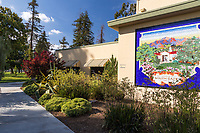 The landscaping (including a gorgeous agave) and South Gate mural next to the main entrance of the Municipal Auditorium at South Gate Park.  Note: a clear plastic bag is visible in the landscaping.