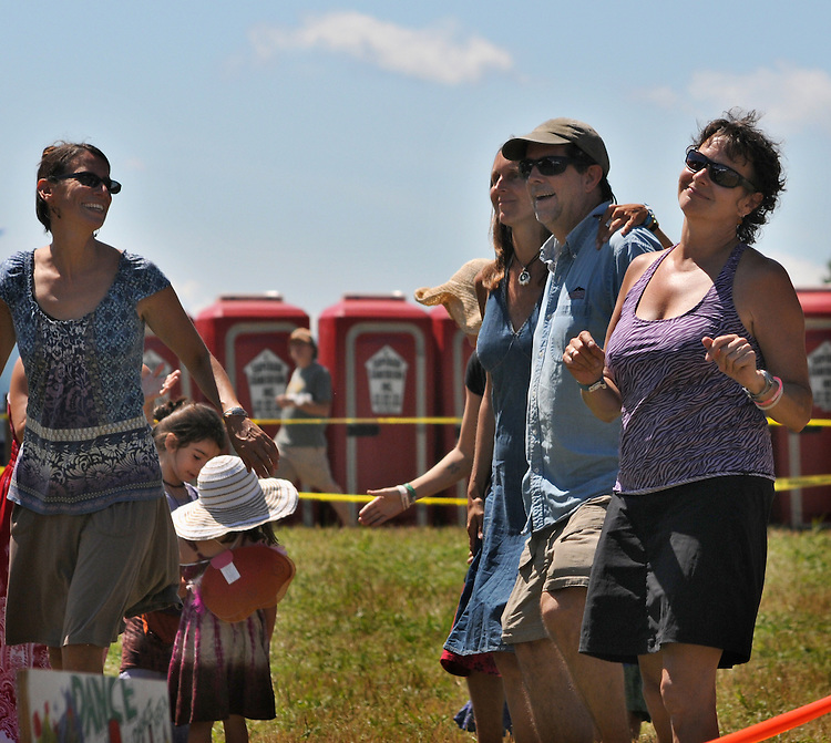 """Members of the audience dancing to the music during the  """"Gospel Wake Up Call"""" Show at the Main Stage at the Falcon Ridge Folk Festival, held on Dodd's Farm in Hillsdale, NY on Sunday, August 2, 2015. Photo by Jim Peppler. Copyright Jim Peppler 2015."""