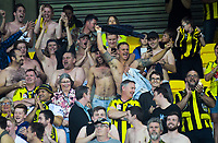 Former All White and Phoenix legend Ben Sigmund (centre) celebrates with fans in the Yellow fever zone during the A-League football match between Wellington Phoenix and Newcastle Jets at Westpac Stadium in Wellington, New Zealand on Saturday, 30 March 2019. Photo: Dave Lintott / lintottphoto.co.nz