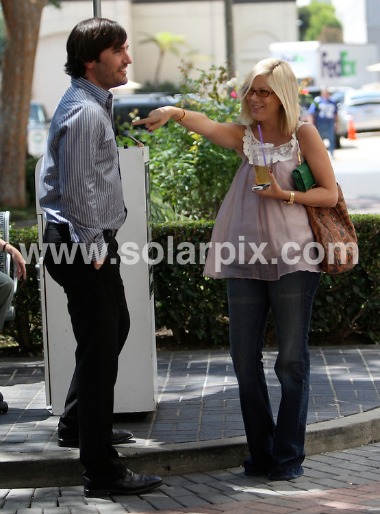 **ALL ROUND PICTURES FROM SOLARPIX.COM**.**WORLDWIDE SYNDICATION RIGHTS EXCEPT FOR USA, AUSTRALIA & GERMANY**.Tori Spelling taking a coffee break yesterday in Los Angeles.JOB REF:  7228    LAS       DATE:  06.09.08.**MUST CREDIT SOLARPIX.COM OR DOUBLE FEE WILL BE CHARGED* *UNDER NO CIRCUMSTANCES IS THIS IMAGE TO BE REPRODUCED FOR ANY ONLINE EDITION WITHOUT PRIOR PERMISSION*