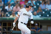 Casey Gillaspie (13) of the Charlotte Knights follows through on his swing against the Toledo Mud Hens at BB&T BallPark on June 22, 2018 in Charlotte, North Carolina. The Mud Hens defeated the Knights 4-0.  (Brian Westerholt/Four Seam Images)