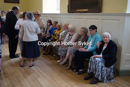 Jankyn Smyth Cake and Ale ceremony at the Guildhall, Bury St Edmunds Suffolk 2015. Residents of the Alms Houses provided for by Jankyn Smyth.
