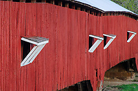 The interesting shingled roofs of windows on a very long covered bridge, the West Union bridge are the focus of this detailed image of the bridge, Parke County, Indiana.