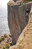 Climbers on Palisade Head on Minnesota North Shore of Lake Superior at Tettegouche State Park.