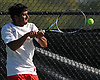 Rahul Mathur of Half Hollow Hills West returns a volley from Avi Anand of Hills East (not in picture) in the third singles match of the Suffolk County varsity boys tennis team championship at Half Hollow Hills High School East on Wednesday, May 17, 2017.