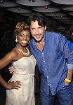 Bold and the Beautiful Ricky Paull Goldin poses with host Delaina Dixon (Daily Gals Diva) of The Gossip Table at the Launch Party to celebrate the new VH1 morning show beginning June 3 - party was on May 30, 2013 at Catch Roof, New York City, New York. (Photo by Sue Coflin/Max Photos)