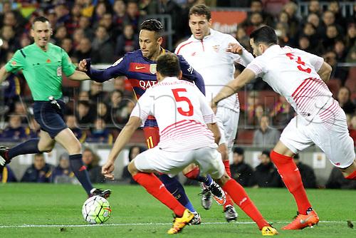28.02.2016. Nou Camp, Barcelona, Spain. La Liga football match Barcelona versus Sevilla. Neymar in action, challenged by thee Sevilla defenders.