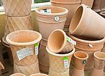 Display of terracotta pots on sale, The Walled garden plant nursery, Benhall, Suffolk, England, UK