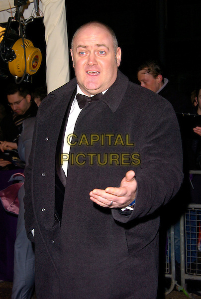 DARA O'BRIEN.British Comedy Awards 2007, London Studios, South Bank, London, England. .December 5th 2007.half length black coat hand mouth open .CAP/CAN.©Can Nguyen/Capital Pictures