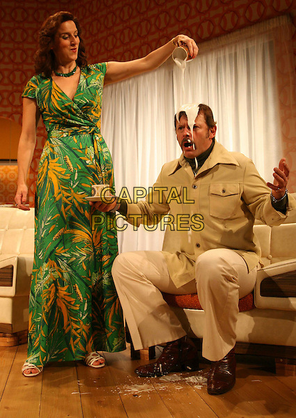 "ABIGAIL THAW & JONATHAN GUY LEWIS .""Absent Friends"" at The Palace Theatre, Watford, London, England, UK, 8th October 2008..play costume character acting on stage live drama actors roles full length cream emptied on head funny green print dress long maxi jug poured pouring .CAP/DS.©Dudley Smith/Capital Pictures"