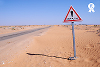 Tunisia, Ksar Ghilane, Sahara Desert, flood warning sign on desert road (Licence this image exclusively with Getty: http://www.gettyimages.com/detail/sb10065474dx-001 )