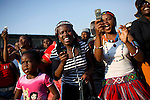 SOWETO, SOUTH AFRICA SEPTEMBER 23: Women take pictures with their mobile phones at a concert on September 23, 2006 in Soweto, Johannesburg, South Africa. The concert was part of Soweto festival. Soweto is South Africa?s largest township and it was founded about one hundred years to make housing available for black people south west of downtown Johannesburg. The estimated population is between 2-3 million. Many key events during the Apartheid struggle unfolded here, and the most known is the student uprisings in June 1976, where thousands of students took to the streets to protest after being forced to study the Afrikaans language at school. Soweto today is a mix of old housing and newly constructed townhouses. A new hungry black middle-class is growing steadily. Many residents work in Johannesburg but the last years many shopping malls have been built, and people are starting to spend their money in Soweto.  .(Photo by Per-Anders Pettersson/Getty Images).