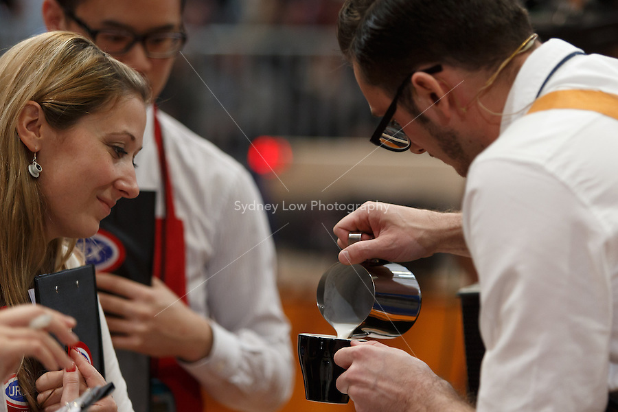 MELBOURNE, 26 MAY - Judge Petra Vesela watches Nick Clark from New Zealand competing in the final of the World Barista Championship 2013 before being announced as coming in 5th place at the Melbourne Show Grounds in Melbourne, Australia. Photo Sydney Low / syd-low.com