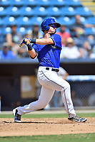 Asheville Tourists designated hitter Tyler Bugner (27) swings at a pitch during a game against the Rome Braves at McCormick Field on September 3, 2018 in Asheville, North Carolina. The Tourists defeated the Braves 5-4. (Tony Farlow/Four Seam Images)