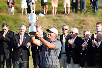 Brooks Koepka (USA) holds up the trophy after winning the 118th U.S. Open Championship at Shinnecock Hills Golf Club in Southampton, NY, USA. 17th June 2018.<br /> Picture: Golffile | Brian Spurlock<br /> <br /> <br /> All photo usage must carry mandatory copyright credit (&copy; Golffile | Brian Spurlock)