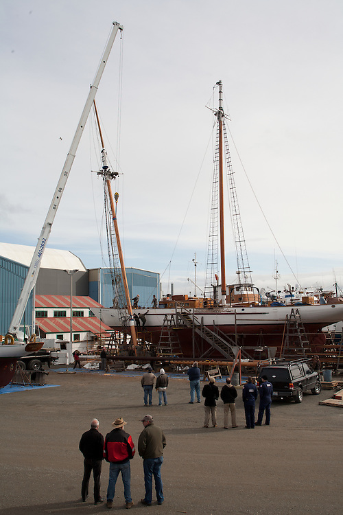 Port Townsend, schooner, Adventuress, stepping the foremast, National Historic Landmark, Boat Haven Marina, Puget Sound, Washington State, boats hauled out in boatyard, Jefferson County, Olympic Peninsula, Pacific Northwest, United States,