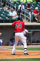 Christian Marrero (24) of the Birmingham Barons at bat against the Tennessee Smokies at Regions Field on May 4, 2015 in Birmingham, Alabama.  The Barons defeated the Smokies 4-3 in 13 innings. (Brian Westerholt/Four Seam Images)