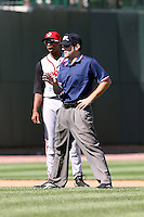 June 15th 2008:  Base umpire Joe Hannigan explains a call as Justin Jackson yawns during a game at Dow Diamond in Midland, MI.  Photo by:  Mike Janes/Four Seam Images
