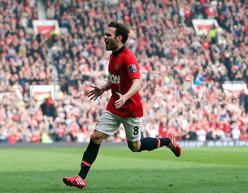 29.03.2014  Manchester, England. Manchester United's  Juan Mata celebrates with the fans after scoring to make it 3-1  during the Premier League game between Manchester United and Aston Villa from Old Trafford