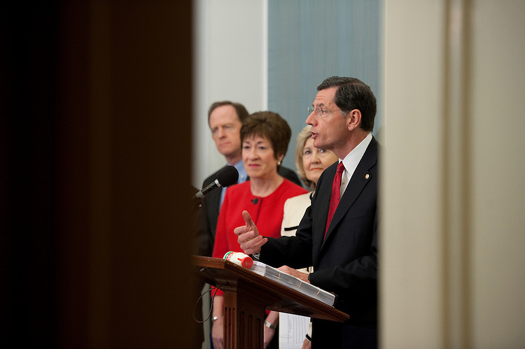 "UNITED STATES - JULY 14: Patrick Toomey, R-Pa., Susan Collins, R-Maine, Kay Bailey Hutchison, R-Texas and John Barrasso, R-Wyo., during a news conference on ""Republican efforts to cut Washington's red tape."" Barrasso is holding a bottle of milk..Location: S-120, U.S. Capitol (Photo By Douglas Graham/Roll Call)"