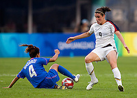 USWNT midfielder (9) Heather O'Reilly is tackled by Japanese defender (4) Azusa Iwashimizu while playing at Qinhuangdao Stadium. The US defeated Japan, 1-0, during first round play at the 2008 Beijing Olympics in Qinhuangdao, China.