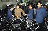 September 29th, 1984. Beijing, China. Japanese products are advertised on large billboards, and the Chinese are buying electronics, clothing, perfume and bicycles to celebrate the 35th anniversary of the revolution.