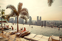 The Sky Park swimming pool on the roof of the Marina Bay Sands resort hotel with spectacular views over the Singapore skyline.