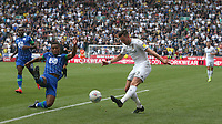 Leeds United's Jack Harrison crosses the ball despite the attentions of Wigan Athletic's Nathan Byrne<br /> <br /> Photographer Stephen White/CameraSport<br /> <br /> The EFL Sky Bet Championship - Wigan Athletic v Leeds United - Saturday 17th August 2019 - DW Stadium - Wigan<br /> <br /> World Copyright © 2019 CameraSport. All rights reserved. 43 Linden Ave. Countesthorpe. Leicester. England. LE8 5PG - Tel: +44 (0) 116 277 4147 - admin@camerasport.com - www.camerasport.com