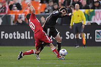 DC United midfielder Ben Olsen (14) gets tackled by Chicago Fire forward Brian McBride (20) Chicago Fire tied DC United 1-1 at  RFK Stadium, Saturday March 28, 2009.