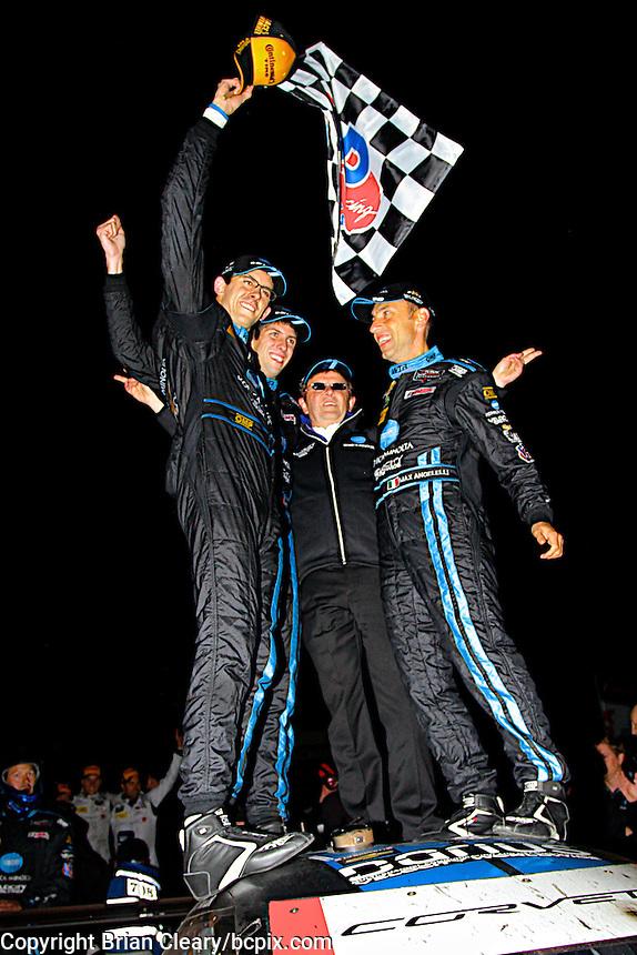 Jordan Taylor, Ricky Taylor, Wayne Taylor, Max Angelelli celebrate, Petit Le Mans , Road Atlanta, Braselton, GA, October 2014.   (Photo by Brian Cleary/www.bcpix.com)