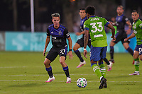 10th July 2020, Orlando, Florida, USA;  San Jose Earthquakes midfielder Carlos Fierro (21) and Seattle Sounders defender Joevin Jones (33) go for the ball during the soccer match between the Seattle Sounders and the San Jose Earthquakes on July 10, 2020, at ESPN Wide World of Sports Complex in Orlando, FL.